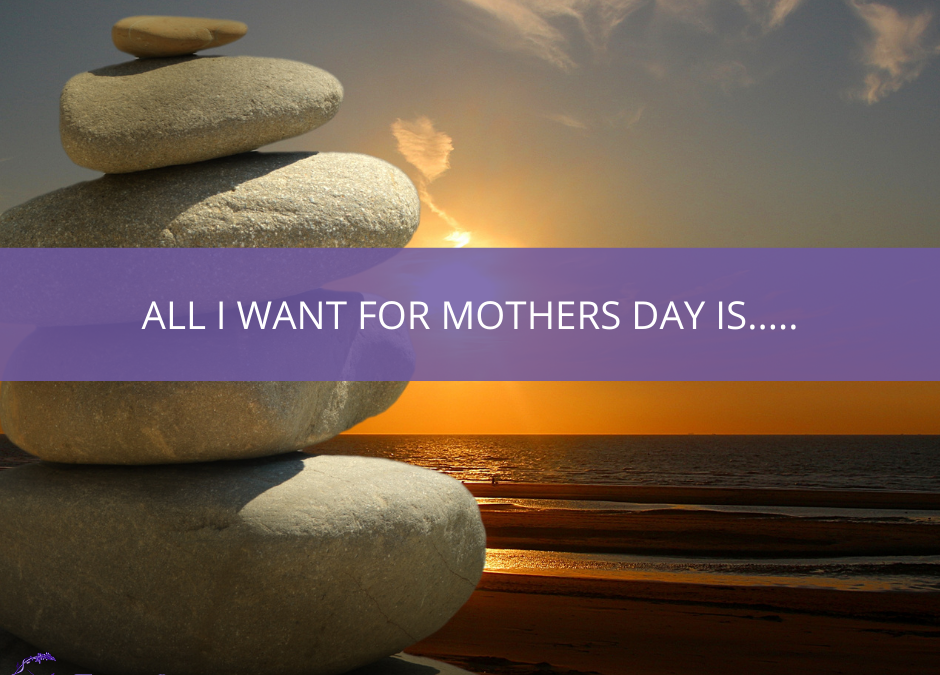 Photography of a beach at sunset with a pile of stones in the foreground and text overlayed that says All I Want for Mothers Day Is