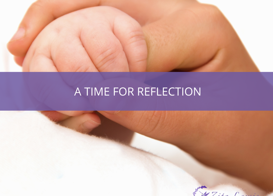 Photography of parent and baby hands entertwined and text overlay that says A Time for Reflection